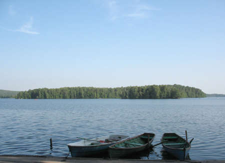 Three boads on a lake photo