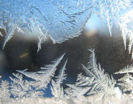 Frosty pattern on winter window photo
