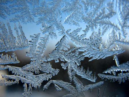 Snow pattern on winter window photo
