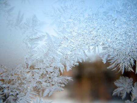 This is frosty pattern on glass winter window photo