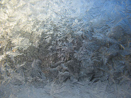 This is snow frosty pattern on winter window photo