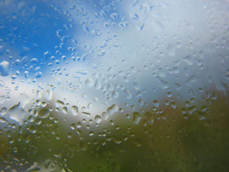 There are window glass and rain drops photo