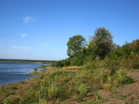 reverberation: There are  river, sky, clouds and small trees Stock Photo