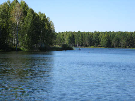 reverberation: There are  river, sky and green trees