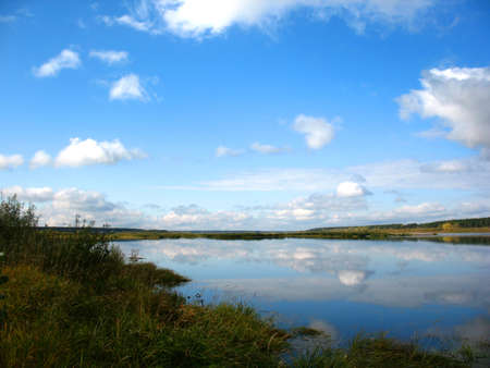 reverberation: river, sky and grass on bank Stock Photo