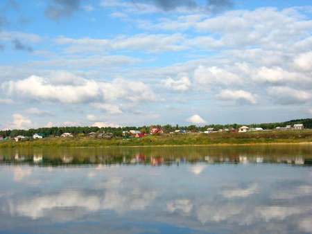 reverberation: There are  river, sky and homes on bank