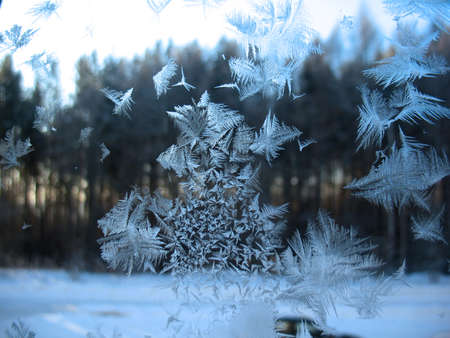 This is frosty pattern on glass winter window Stock Photo