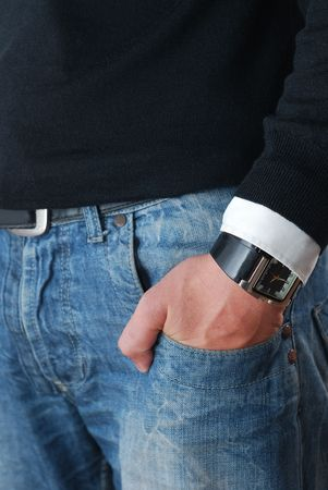 detail of classic refined denim. mans hand with smart watch