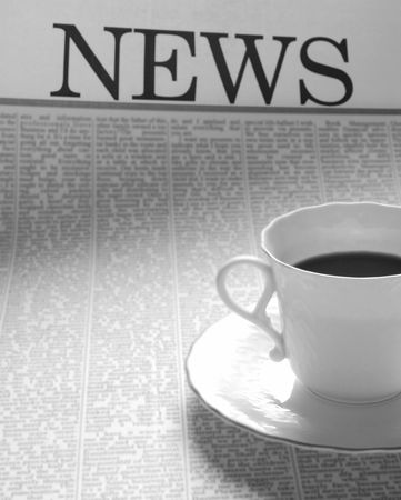 coffee cup on a newspaper page. news on breakfast.  Stock Photo - 3324722