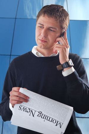 stockholder: young businessman read morning news Stock Photo