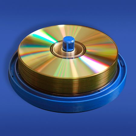 rewritable: CD and DVD discs,  isolated on blue background.