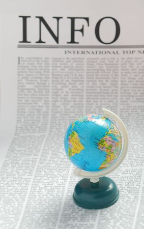 small globe on a  newspaper page. info media Stock Photo - 3324955
