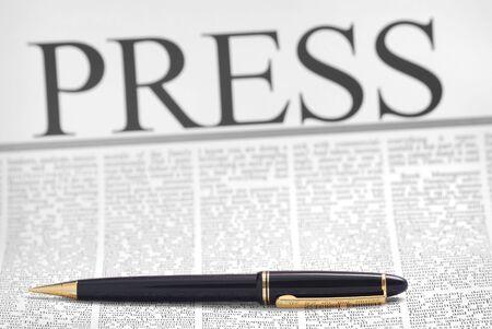 actuality: press headline, luxury pen on newspaper page Stock Photo