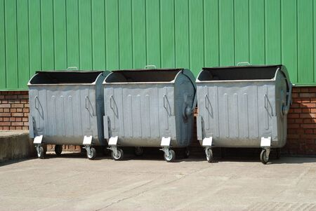 consummation: urban trash containers in backyard Stock Photo