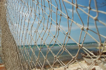 trawl: color nets on the beach Stock Photo