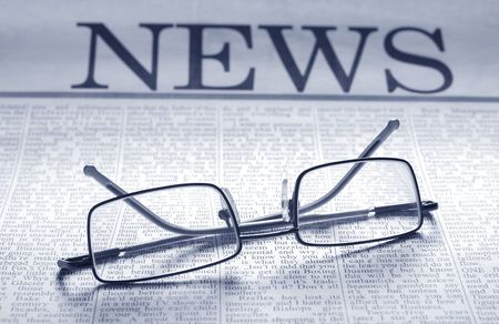 smart glasses on newspaper page. top news Stock Photo - 3369731