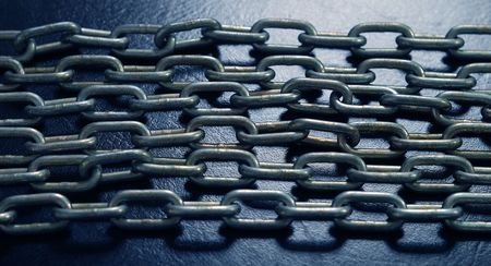 chainlinks: strong chains on the dark blue light. horizontal background