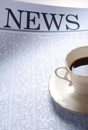 actuality: coffee cup on a newspaper page.