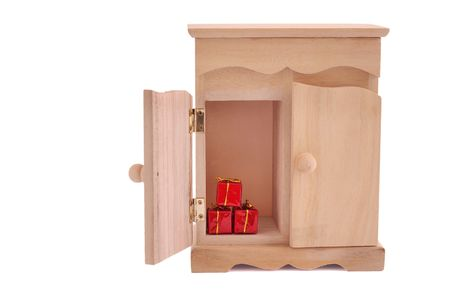 concealed: surprise of small cupboard isolated on white, with clipping path