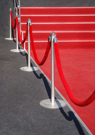 Portable Barrier for Queue Control. Red security rope by red carpet. event object photo