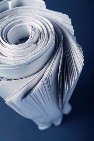 Roll of newspapers, isolated on dark background Stock Photo - 4724937