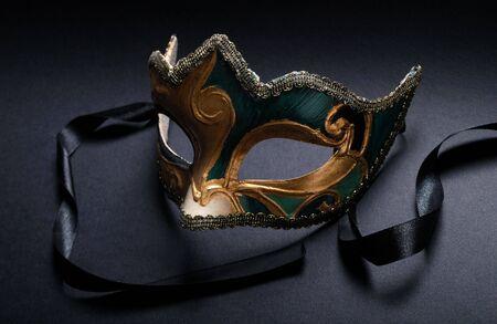 Venice mask.  decorative carnival masque on black photo