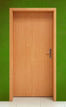 Wooden door on green wall Stock Photo - 4826800