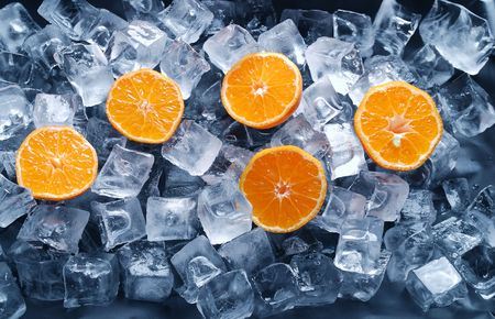 Orange slices in the ice. photo
