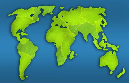 Green earth planet  from fresh leaves. map of the world. isolated on blue photo