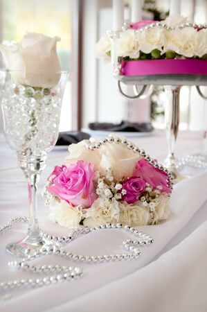 wedding table setting: Wedding reception place ready for guests. pink color style accent