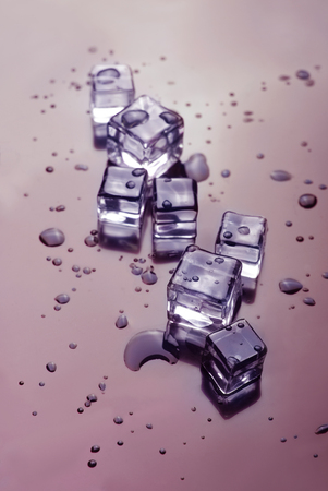icecubes: ice cubes wet and melting . drink background