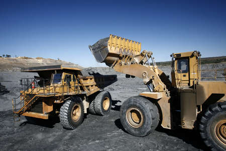 heavy equipment: excavator and truck working in mine. brazil Stock Photo