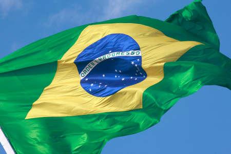 brazilian flag with a blue sky Imagens