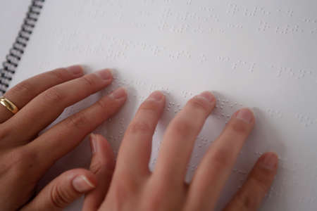 hands read the braille code photo