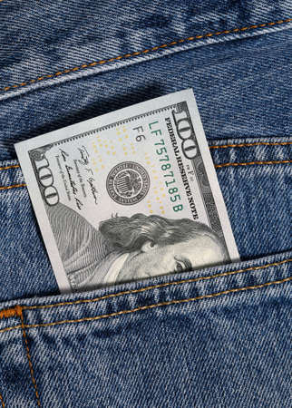 one hundred dollar in jeans pocket photo