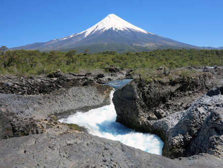 The Petrohue Falls and Osorno Volcano with its snow peak in Puerto Varas, south of Chile. Stock Photo