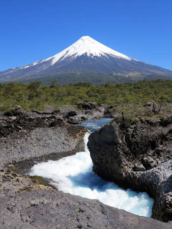 The Petrohue Falls and Osorno Volcano with its snow peak in Puerto Varas, south of Chile.  photo