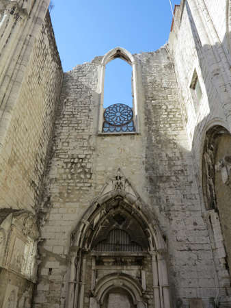 Ruins of the 14th-15th century Gothic church Igreja do Carmo in Lisbon, Portugal. Damaged by the earthquake in 1755. photo