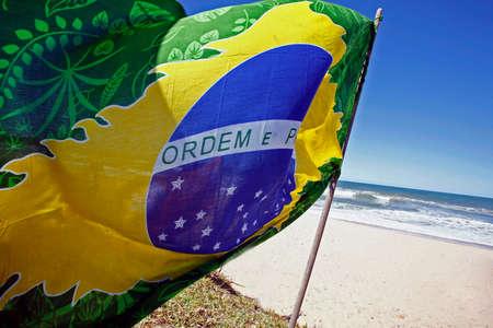 stylized brazilian flag on sunny day in beach, brazil