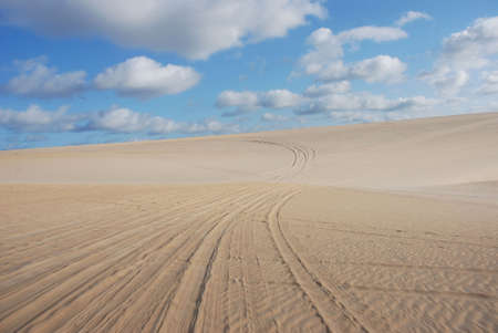 natal: dunes of genipabu with blue sky and clouds, natal, brazil