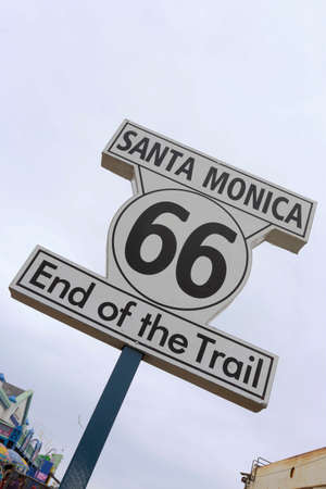 end of the trail: traditional sign of finish of route 66 on pier santa monica, los angeles, california, usa