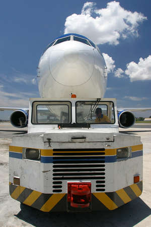 carried: aircraft is carried by the vehicle in airport