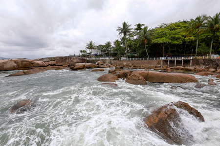 sea waves crash on the rocks in coast of Palmas island in santos, sao paulo state, brazil