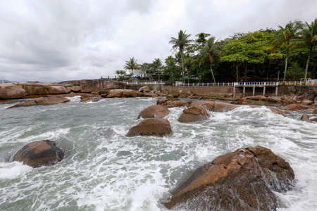 sea waves crash on the rocks in coast of Palmas island in santos, sao paulo state, brazil