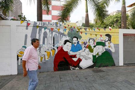 CARACAS, VENEZUELA - MAY 06, 2014 - design in wall of street with hugo chaves, ernesto che guevara, nicolsa maduro e fidel castro playing domino