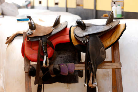 leather saddle horse in easel in a ranch Stock Photo