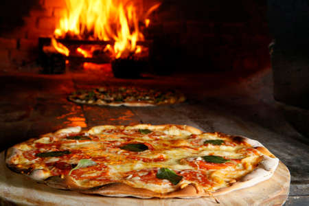 Pizza in oven of wood fire