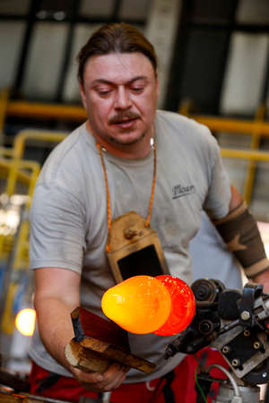 KARLOVY VARY, CZECH REPUBLIC - JUNE 01, 2017 - Glass blowers demonstrate their craft, a popular tourist attraction in Bohemia region