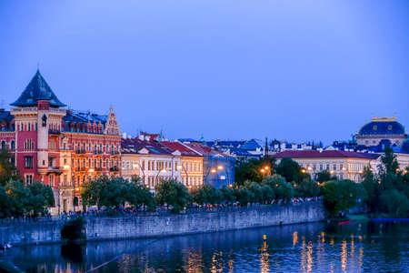 Prague, Czech Republic - may 31 2017 - tourists watch the sunset on the river Vltava, Prague