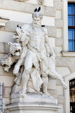 sculpture of Hercules and Cerberus at Vienna Hofburg Imperial Palace at day, Austria Redakční